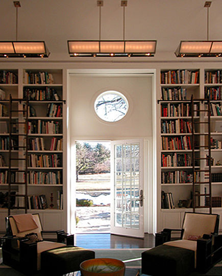 Behind the fixture's backlit sandblasted panels is a concealed row of long-life MR16 directional lights in three, separately controlled groups.  These lights illuminate the ceiling, wash-light the built-in bookshelves and accentuate the artwork and fireplace.