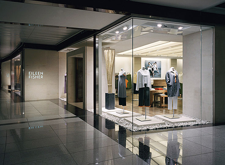The minimalist aesthetic of Eileen Fisher's fashion line is echoed by the interior of her flagship store. Our task was to support this atmosphere with a tranquil ambience while providing the variety of light levels required for today's retail environment.