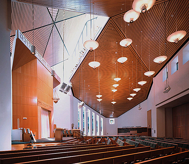 The pendant fixture type which illuminates the 40-foot high Main Hall is a custom assembly of a standard cylindrical down-light and a 30-inch diameter decorative diffuser. The diffuser also contains up-lights to illuminate the wood-paneled ceiling.