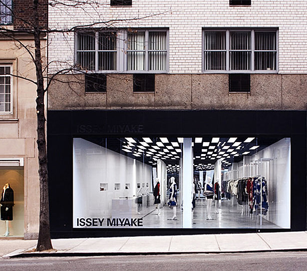 """The storefront glass panel of Miyake's Madison showroom spans the entire 26-foot wide exterior wall, visually opening the store's interior to the street. The syncopated rhythm of alternating fluorescent light-boxes and black voids of exposed ceiling sets up an """"op-art"""" plane - provoking the attention of passers-by."""