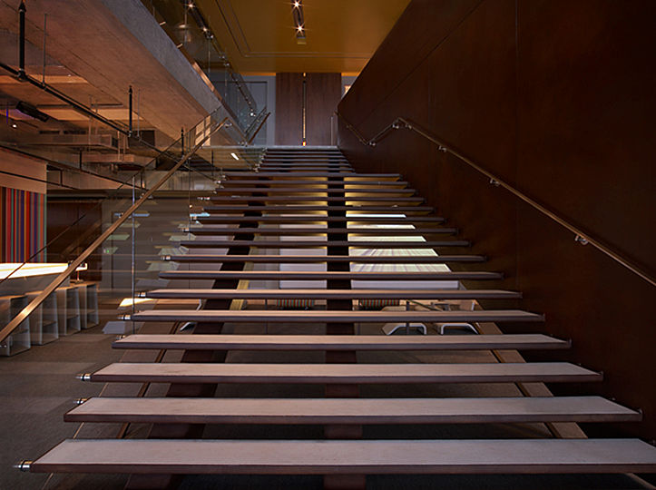 The centerpiece of the headquarters is its asymmetrical stairway, which double-functions as an amphitheater with seating for staff meetings.